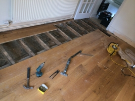 Wood & Laminate Flooring - A Wooden Floor in the Process of being Laid